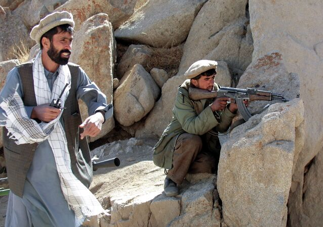 An Afghan anti-Taliban Northern Alliance soldier shoots at positions held by the ruling religious militia close to the strategically important Salang heights, around 100 kms north of the capital Kabul, 26 September 2001, under the orders of his commander
