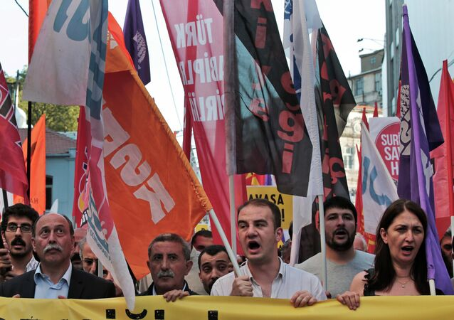 Protesters from unions and the pro-Kurdish Democratic Party of Peoples (HDP) chant slogans against any Turkish forces intervention in Syria, during a march in Istanbul, Thursday, July 2, 2015