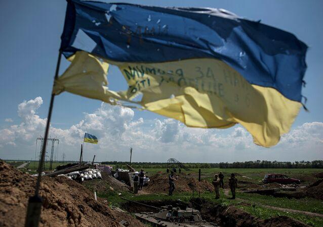 A Ukrainian flag flutters at the Ukrainian position in Marinka, near Donetsk, eastern Ukraine, Friday, June 5, 2015