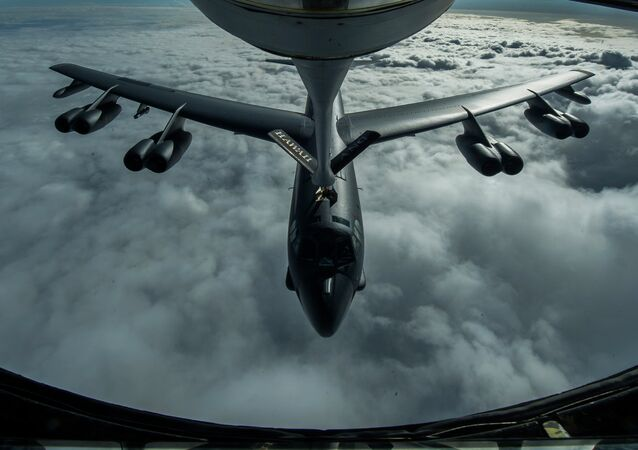 A B-52 Stratofortress is refueled in-flight over the Pacific Ocean.