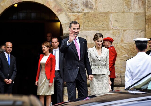 Spain's King Felipe VI walks with Queen Letizia