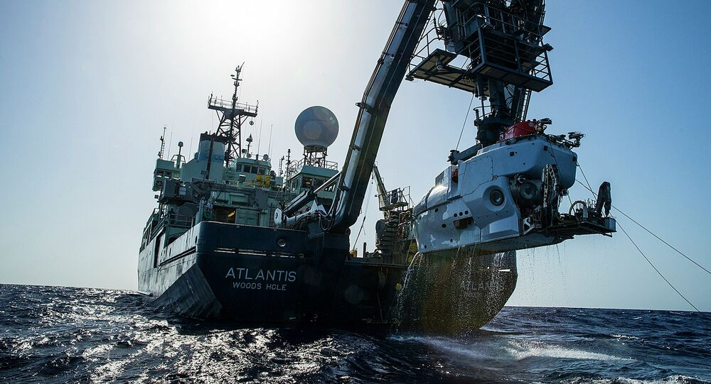 In this image released by, The Woods Hole Oceanographic Institution, the research vessel Atlantis is shown off the coast of the Carolinas in the Atlantic Ocean during the second week of July 2015 with the submersible Alvin hanging off its stern