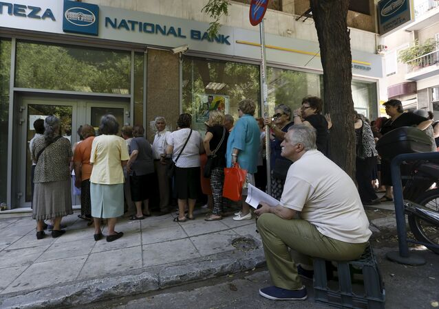 Pensioners wait in front of a National Bank branch to receive part of their pensions at an Athens neighborhood, in Greece July 9, 2015