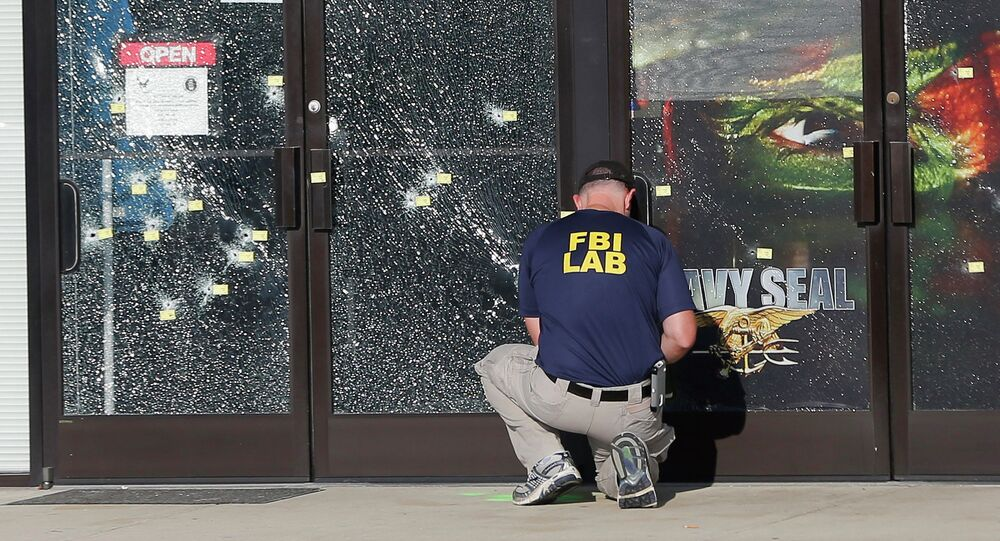 FILE - In this July 17, 2015 file photo, an FBI investigator investigates the scene of a shooting outside a military recruiting center in Chattanooga, Tenn