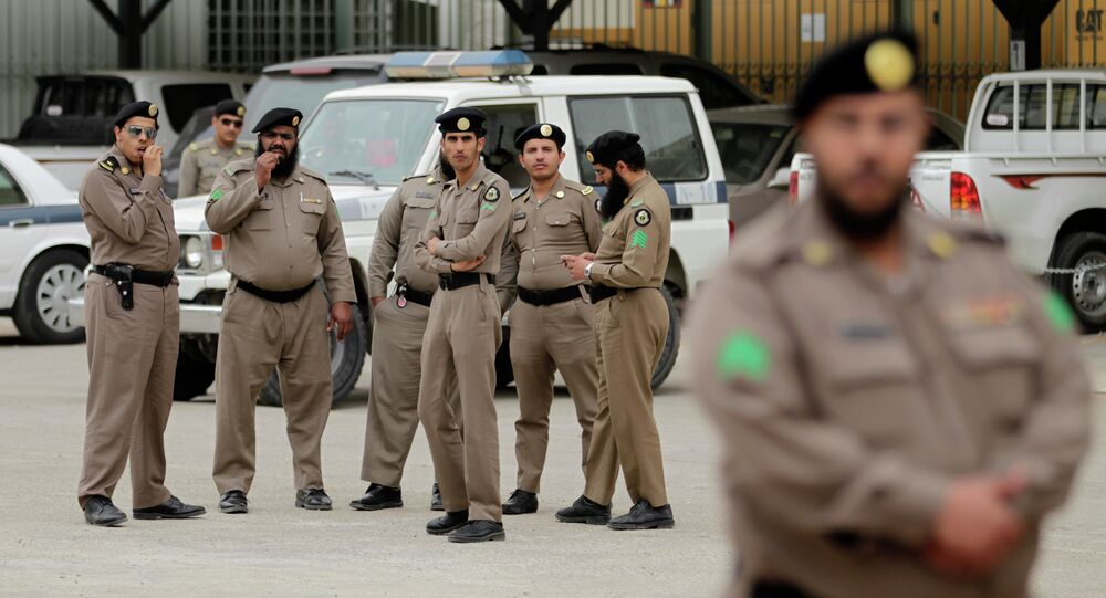 Saudi policemen form a check point near the site where a demonstration was expected to take place in Riyadh, Saudi Arabia, Friday, March 11, 2011