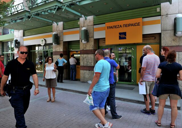 People queue outside a bank in Thessaloniki on July 6, 2015