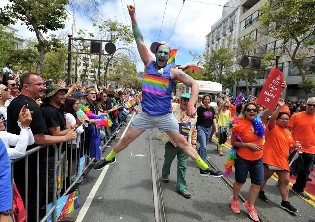 Benj Curtis jumps for joy during the annual Gay Pride Parade in San Francisco, California on June 28, 2015, two days after the US Supreme Court's landmark ruling legalizing same-sex marriage nationwide
