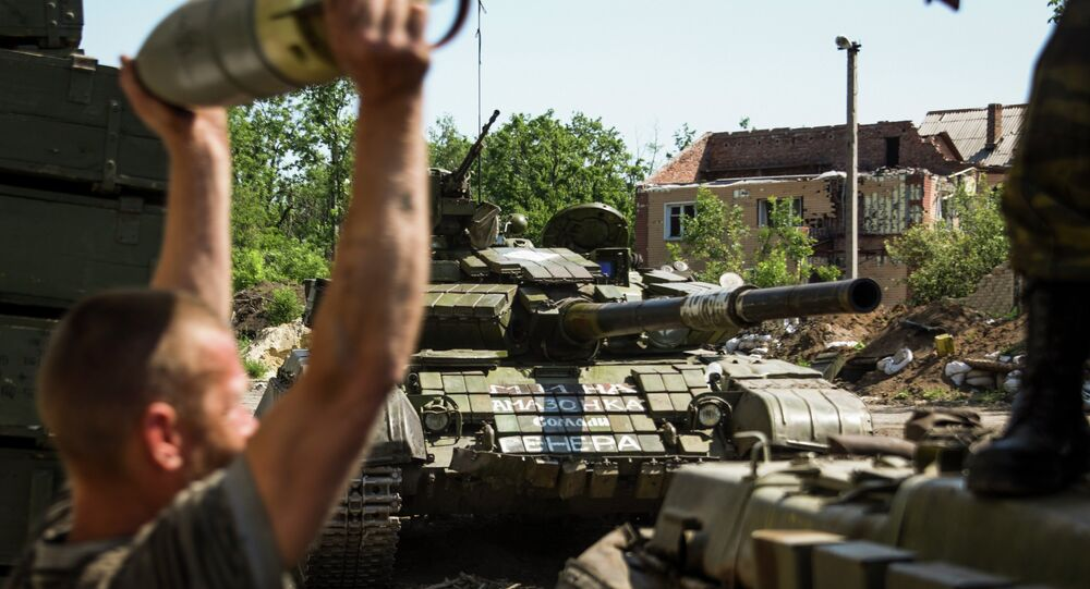 Member of the self-proclaimed Donetsk People's Republic forces loads shells in a tank at Donetsk airport, eastern Ukraine, Friday, June 12, 2015