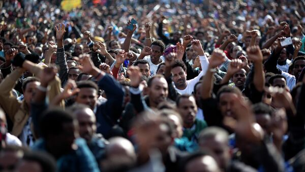 FILE - In this Sunday, Jan. 5, 2014 file photo, African migrants chant slogans during a protest in Rabin's square in Tel Aviv, Israel. Dozens of Africans have accepted an Israeli government offer to relocate to Uganda - Sputnik International