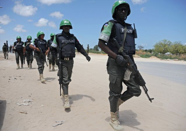 African Union Mission in Somalia (AMISOM) officers patrol around the Gashandhiga academy compound during celebrations of the 55th anniversary day of the Somali military force on April 12,2015 in Mogadishu