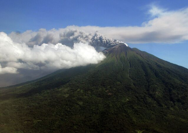 In this Sunday, Sept. 16, 2012 aerial shot, Mount Gamalama spews volcanic ash as it erupts on Ternate Island, eastern Indonesia