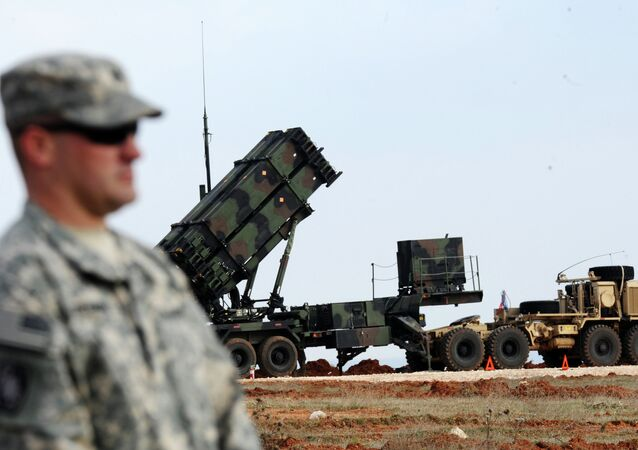A US soldier stands in front of a Patriot missile system at a Turkish military base in Gaziantep on February 5, 2013
