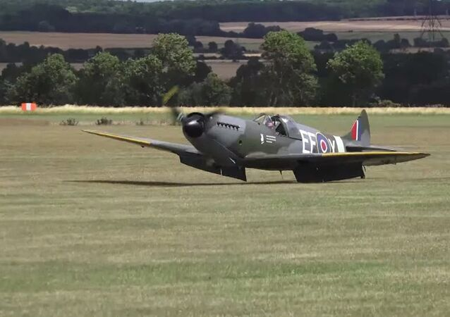 Dramatic moment a Spitfire lands without any wheels