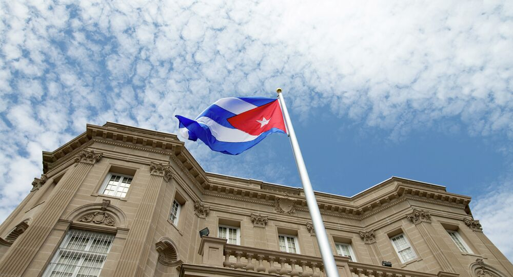 The Cuban flag is raised over their new embassy in Washington, Monday, July 20, 2015