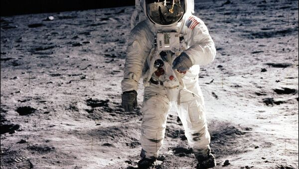 This picture taken 21 July 1969 of astronaut Edwin E. Aldrin Jr. walking on the surface of the moon near the leg of the Lunar Module (ML) Eagle and astronaut Neil Armstrong, during the Apollo 11 extravehicular activity (EVA). NASA no longer knows the whereabouts of the original tapes of man's first landing on the moon nearly 40 years ago, an official of the US space agency said 15 August 2006 - Sputnik International