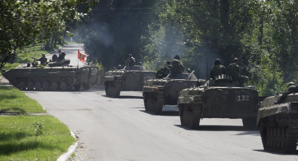 Members of the self-proclaimed Donetsk People's Republic forces ride on armoured personnel carriers (APC) near the urban settlement of Zaytsevo in Donetsk region, Ukraine, July 20, 2015