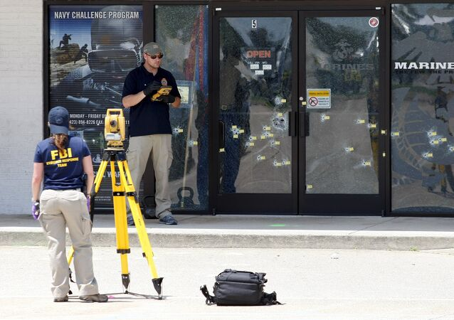 FBI agents continue their investigation at the Armed Forces Career Center in Chattanooga, Tennessee July 17, 2015.