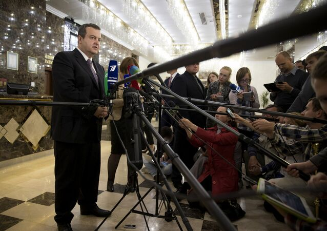 Organization for Security and Co-operation in Europe (OSCE) Chairperson-in-Office, Serbian Foreign Minister Ivica Dacic (L) addresses the media after a meeting of the so-called Contact Group in Minsk, Belarus, July 21, 2015. The Contact Group on eastern Ukraine brings together representatives of Ukraine, Russia, separatist self-proclaimed republics and the Organisation for Security and Co-operation in Europe (OSCE)