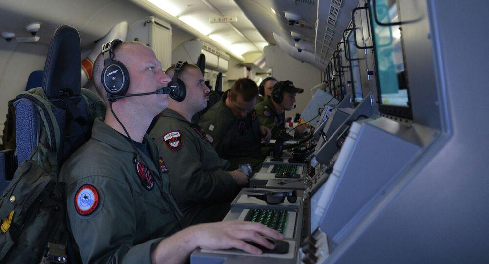 Crew members aboard a P-8A Poseidon.