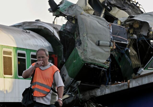 A rescue worker leaves the scene of the accident of a long-distance, international passenger train.