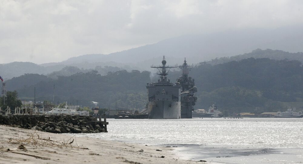 U.S. warships are seen docked at Subic bay in Olongapo city, north of Manila, Philippines in this October 14, 2014 file photo