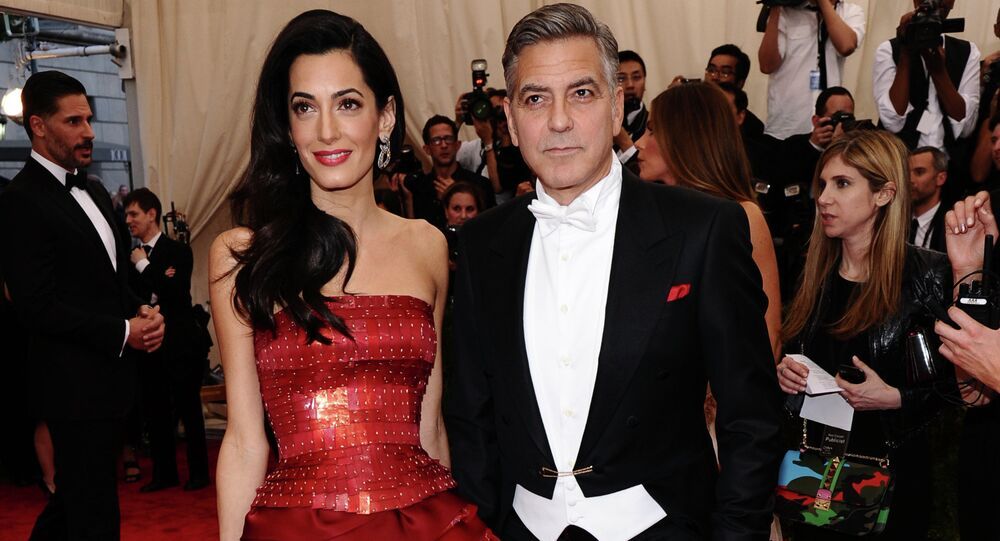 Amal and George Clooney arrive at The Metropolitan Museum of Art's Costume Institute benefit gala.