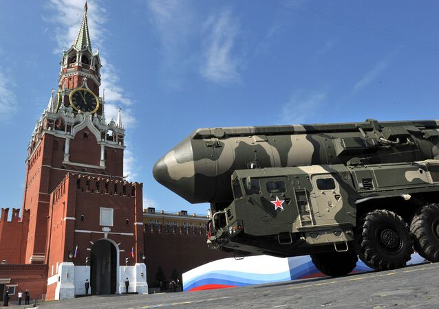 Russian Topol-M intercontinental ballistic missiles drive through Red Square during the Victory Day parade in Moscow on May 9, 2010