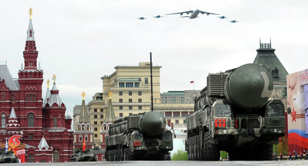 Russian Topol-M ballistic missiles drive through Red Square during a Victory Day parade rehearsal in Moscow on May 6, 2010