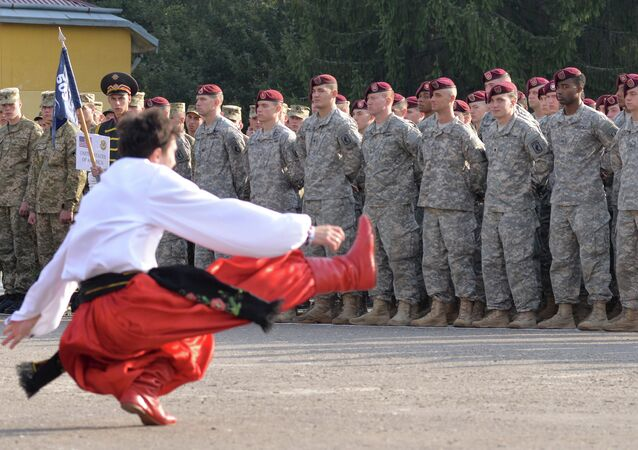 A dancer in Ukrainian national costume performs during the opening ceremony of the Rapid Trident military exercises on September 15, 2014 near the western Ukrainian town of Yavoriv