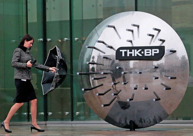 A woman walks outside the TNK-BP headquarters in Moscow, Russia.