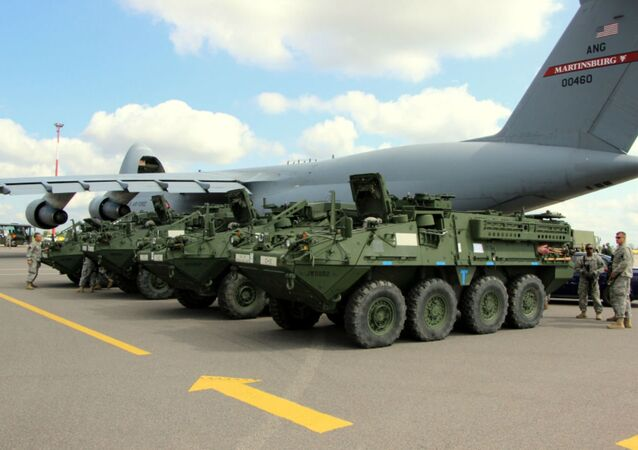 Elements from the Pennsylvania National Guard's 56th Stryker Brigade Combat Team arrive at Vilnius International Airport for participation in the multinational exercise Saber Strike 2014, June 7, 2014.