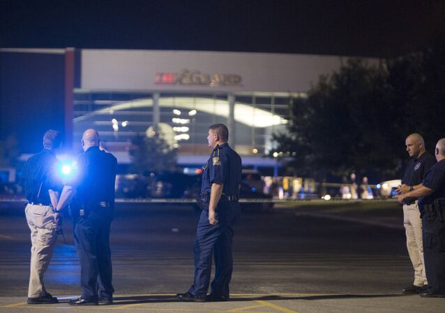 Officials stand by the scene outside the movie theatre where a man opened fire on film goers in Lafayette, Louisiana July 23, 2015