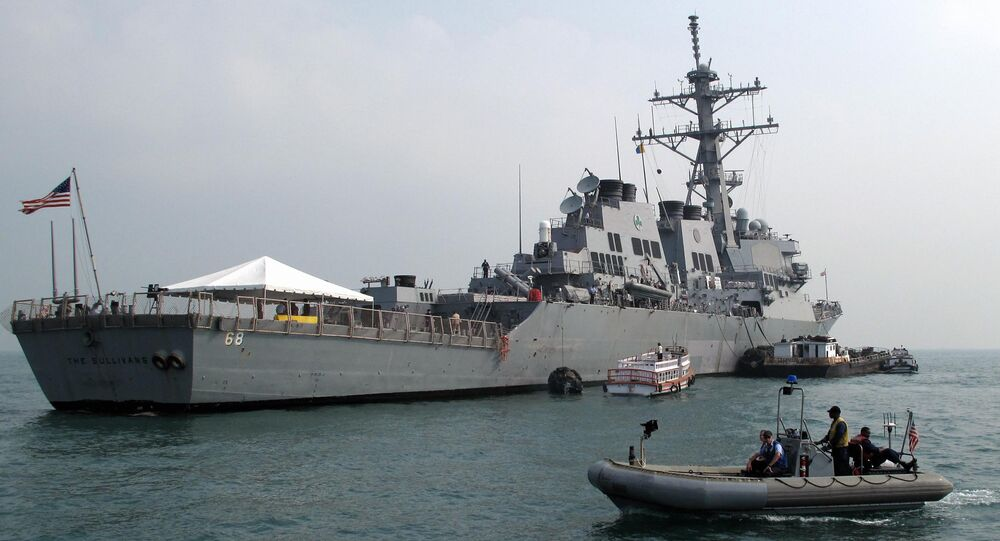 A patrol boat guards the USS The Sullivans (DDG-68)