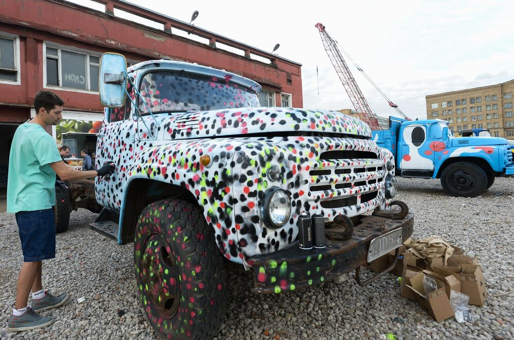 Artists transform old Russian trucks with bright colors and creative patterns.