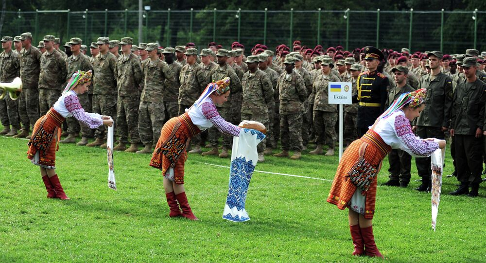 Ukrainian folk dancers perform for Ukrainian and US servicemen in a ceremony for joint-drill exercises between the two countries in Yavoriv polygon, Lviv district, western Ukraine on July 20, 2015