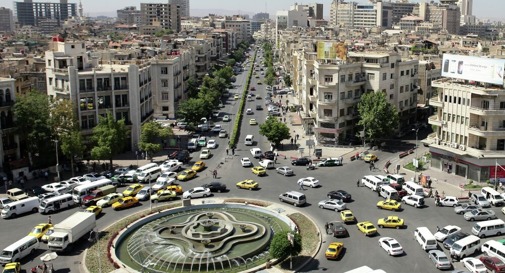 A general view shot taken on June 30, 2015, shows traffic on a roundabout in the Syrian capital Damascus