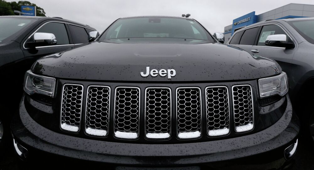 Rain drops rest on the hood of a Jeep Grand Cherokee at Bill DeLuca's dealerships in Haverhill.