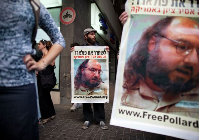 Israeli protesters hold posters demanding the release of Jonathan Pollard, a Jewish American who was jailed for life in 1987 on charges of spying on the United States, as they stand outside the U.S. embassy in Tel Aviv, Israel.