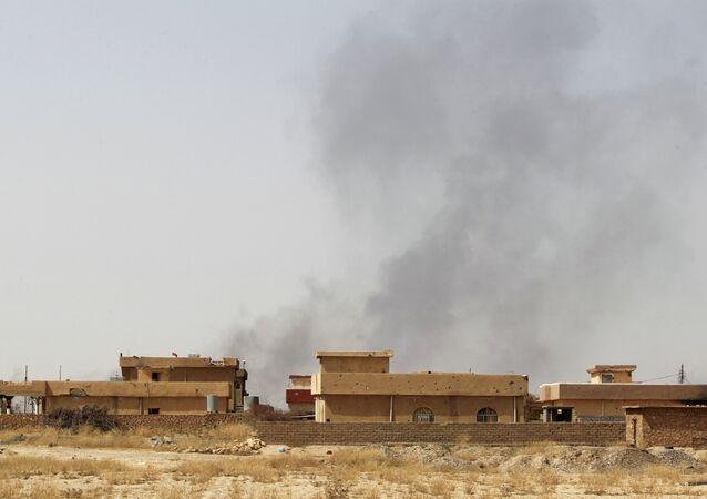 Smoke rises from the town of Baiji, north of Tikrit
