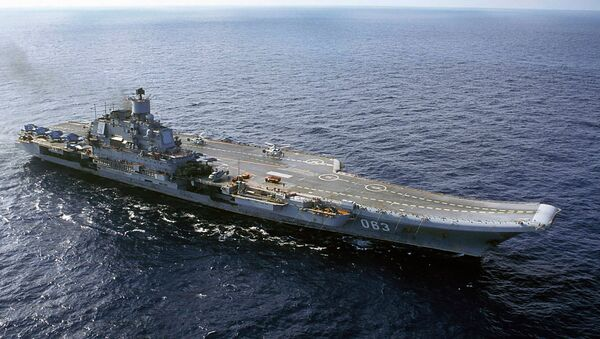 In this file photo from 2004, the Russian Navy's Admiral Kuznetsov aircraft carrier is seen in the Barents Sea, Russia - Sputnik International