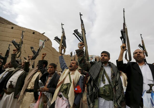 Armed Houthi followers demonstrate against Saudi-led air strikes in Yemen's capital Sanaa July 24, 2015