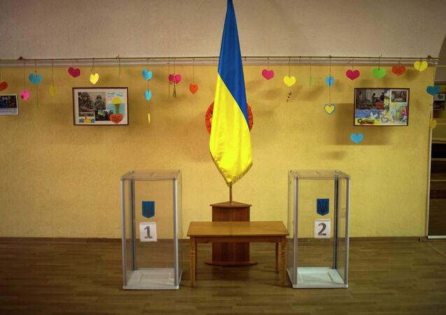 Ballot boxes await use inside a polling station in central Kiev, Ukraine, Friday, Oct. 24, 2014