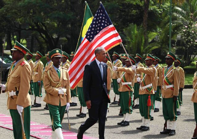 U.S. President Barack Obama (C) reviews a marsh band during a welcome ceremony at the National Palace in Addis Ababa, Ethiopia July 27, 2015.