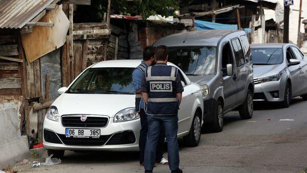 Police officers stand as Turkish police raide homes in Haci Bayram neighborhood in the capital Ankara, Turkey, Monday, July 27, 2015 - Sputnik International