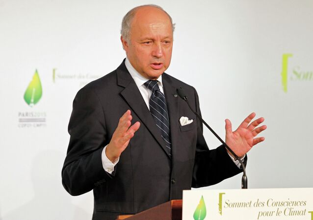 French Foreign Minister Laurent Fabius delivers a speech during the a climate meeting in Paris, France, Tuesday, July 21, 2015