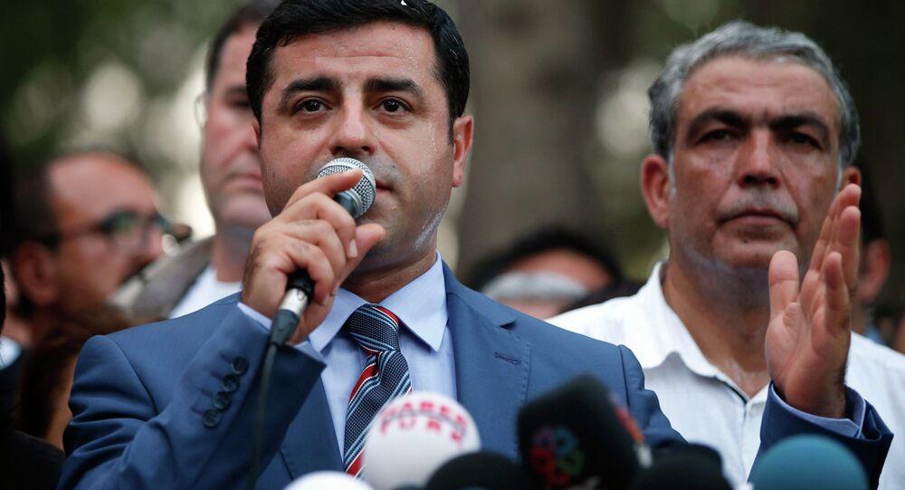 Co-chairman of the pro-Kurdish Peoples' Democracy Party Selahattin Demirtas speaks in Suruc, Turkey, Tuesday, July 21, 2015