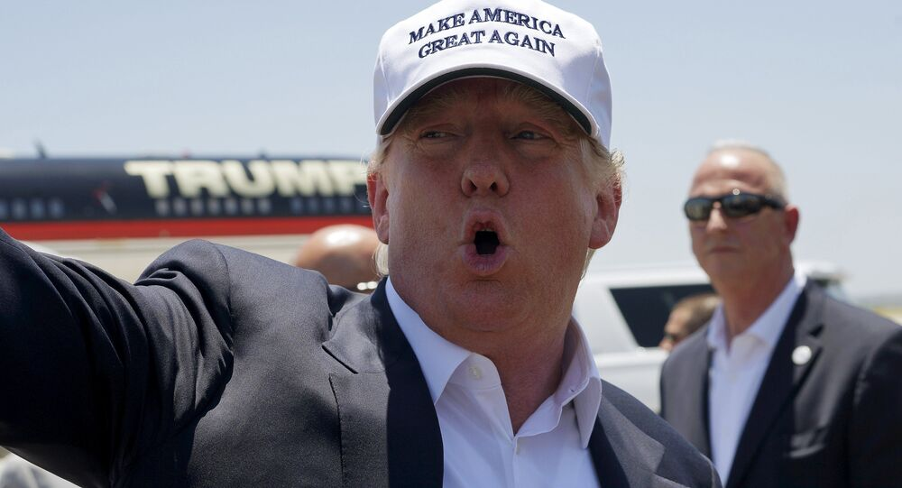 Republican presidential candidate Donald Trump talks to reporters as he arrives in Laredo, Texas July 23, 2015.