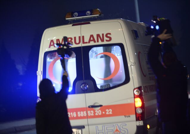 People film as an ambulance drives out of the airport in Istanbul on February 7, 2014. File photo