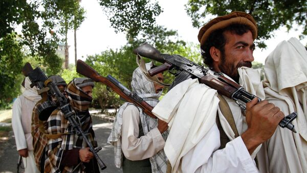 Taliban fighters hold their heavy and light weapons before surrendering them to Afghan authorities in Jalalabad, east of Kabul, Afghanistan. File photo - Sputnik International