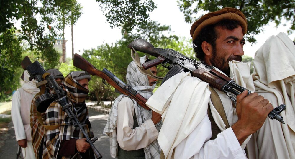 Taliban fighters hold their heavy and light weapons before surrendering them to Afghan authorities in Jalalabad, east of Kabul, Afghanistan. File photo